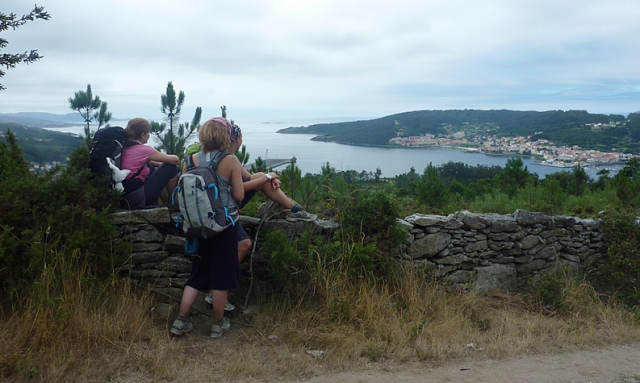 On the descent to Cee pilgrims have their first glimpse of the sea